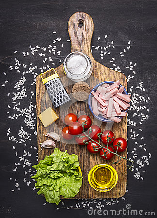 Free Ingredients For Risotto With Ham, Vegetables And Spices On A Cutting Board On Wooden Rustic Background Top View Close Up Royalty Free Stock Image - 64613566