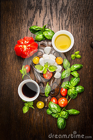 Free Ingredients For Salad With Mozzarella And Tomatoes: Oil, Balsamic Vinegar And Fresh Basil On Dark Rustic Wooden Background Stock Photography - 53700872