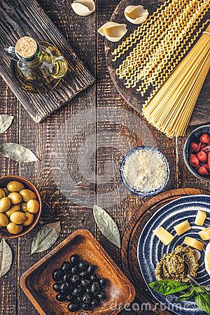 Free Ingredients Of Italian Cuisine On The Wooden Table Vertical Stock Photo - 75007710