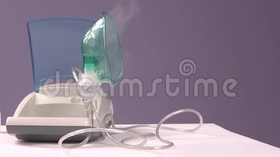 Inhalation. The doctor gives the patient a mask for inhalation stock video