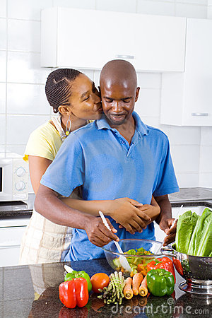 Initmate couple in kitchen