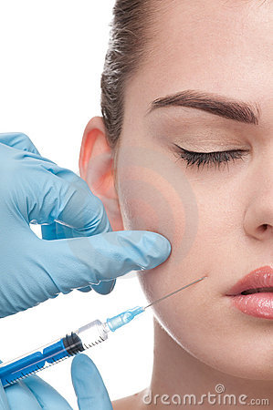 Injection of botox to the face of beautiful woman