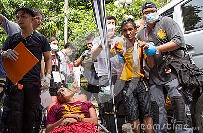 Injured devotees during Feast of Black Nazarene in Manila, Philippines Editorial Photo