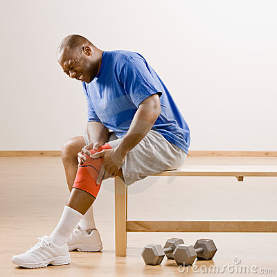 Injured man holding knee splint
