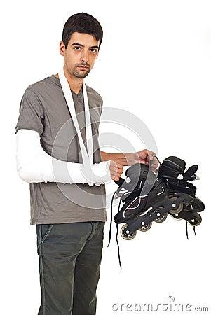 Injured man holding rollerskating
