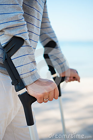 Injured Man standing with Crutches