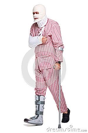 Injured man walking away on crutches