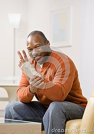 Injured man with wrist splint gesturing