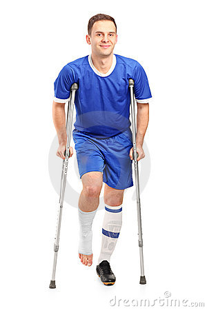 Injured soccer football player on cru