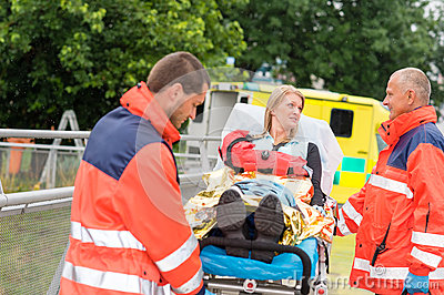 Injured woman talking with paramedics emergency