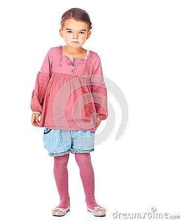 Innocent little girl looking upset on white