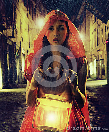 Free Innocent Woman In Red Holding The Lantern Stock Photos - 29777633