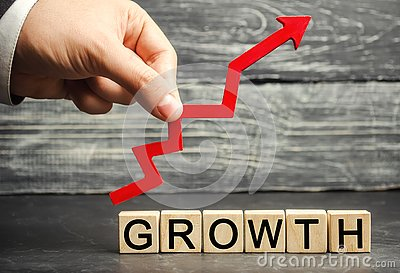 The Inscription Growth and up arrow. The concept of a successful business. Increase in income, salary. The growth of the company` Stock Photo