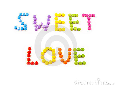 Inscription love from coloured chocolate candy
