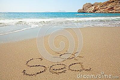 Inscription on wet sand