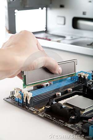 Free Inserting DDR 3 Memory In The Socket Stock Photos - 11938993
