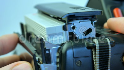 Inserting The Video Cassette Into 8mm Camera Stock