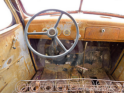 Inside cab view of rusty old junked pickup truck