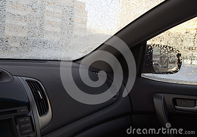 Inside the car in frosty wintertime