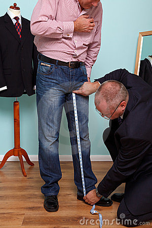 Inside leg measured by a tailor for a suit