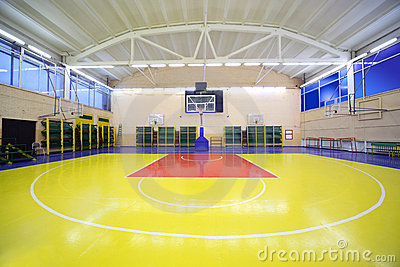 Inside school gym hall with red-yellow floor