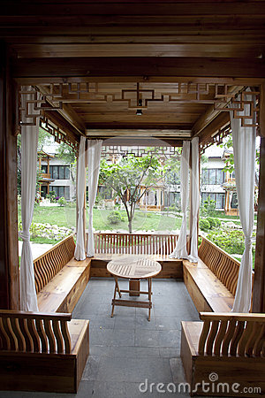 Inside of wooden gazebo with table