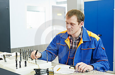 Inspector Worker At Factory Manufacturing Royalty Free Stock Photo - Image: 21624275