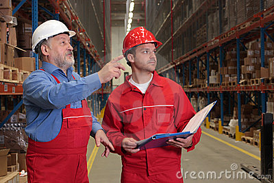 Inspectors in warehouse