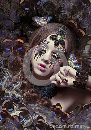Free Inspiration. Woman With Fantastic Teardrops And Butterflies Stock Image - 48548771
