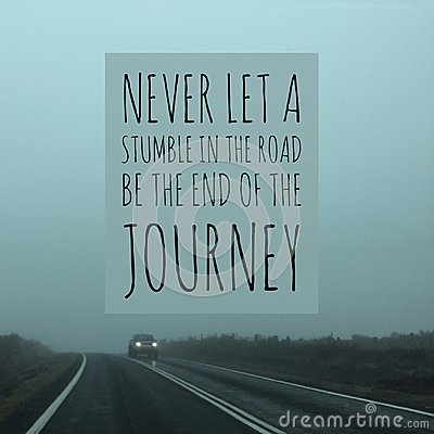 Inspirational motivational quote `never let a stumble in the road be the end of the journey` Stock Photo