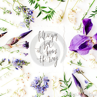Free Inspirational Quote `follow Your Soul It Knows The Way` Written In Calligraphy Style On Paper With Wreath Frame With Purple Iris F Stock Photography - 72265392