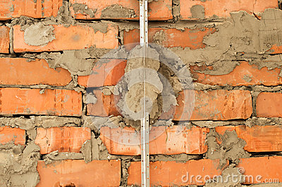 Installation Of Metal Lighthouses On A Brick Wall Stock