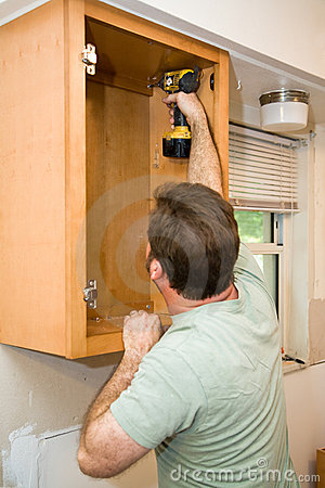 Free Installing Cabinets Stock Image - 6883541