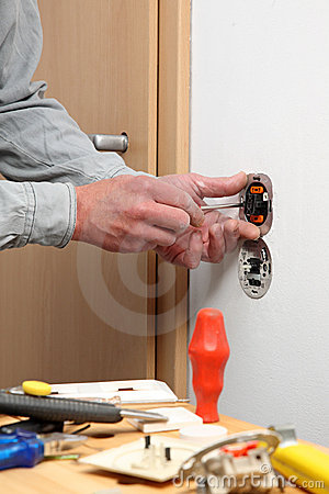 Installing a light switch.