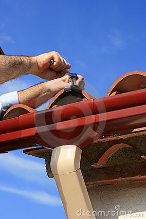 Free Installing Rain Gutter Stock Photography - 2646262