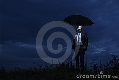 The Insurance Agent holding Umbrella