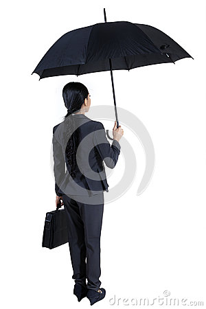 Insurance agent holding a umbrella -  isolated