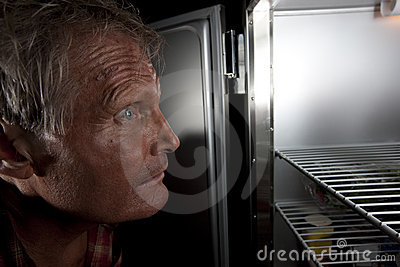 Intense Man Staring Into Refrigerator