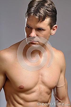 Intense muscular man