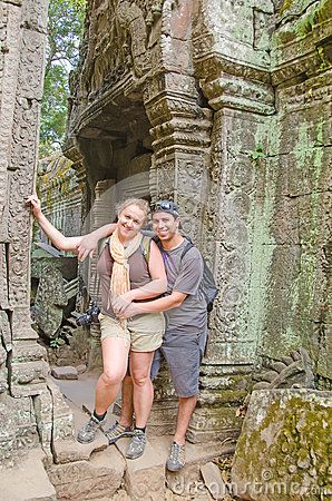 Inter ethnic couple of tourists in Angkor Wat complex