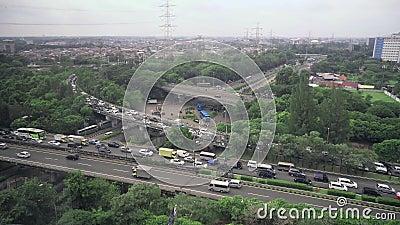 Intercâmbio da estrada em Jakarta no dia nebuloso filme