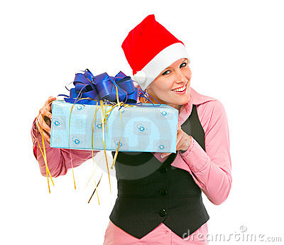 Interested business woman shaking present box