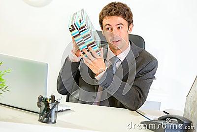 Interested businessman shaking present box