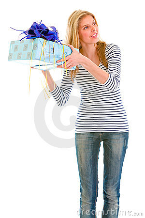 Interested teengirl shaking present box