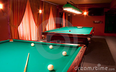 Interior of a club having billiard tables