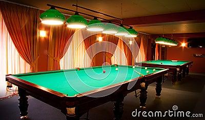 Interior of a club having billiard tables