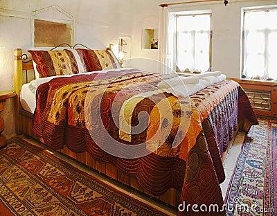 Interior design cave bedroom multi colored bedding