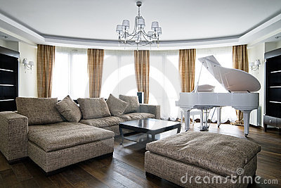 Interior of light living room with white piano