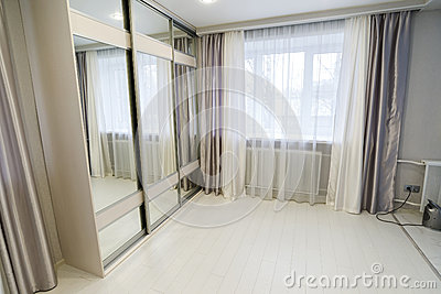 interior of living room with window and mirror wardrobe Stock Photo