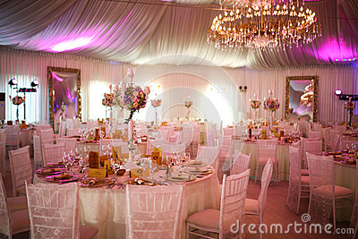 Interior of a luxury white wedding tent decoration ready for guests